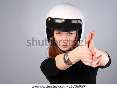 young beautiful woman in black clothes and white helmet