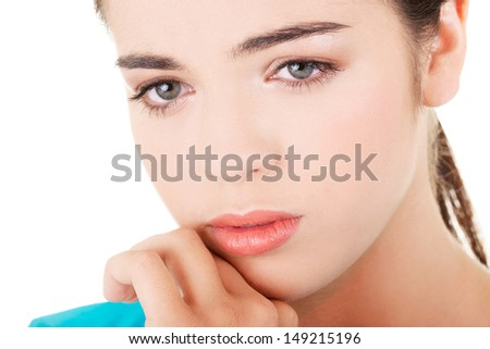 Young beautiful woman in depression. Isolated on white background.  - stock photo