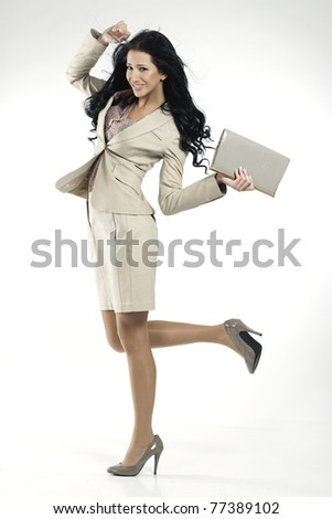 young beautiful woman in elegant beige suit - stock photo