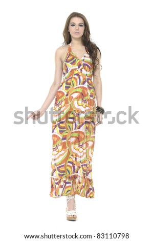 Young beautiful woman in evening dress walking Isolated Studio - stock photo
