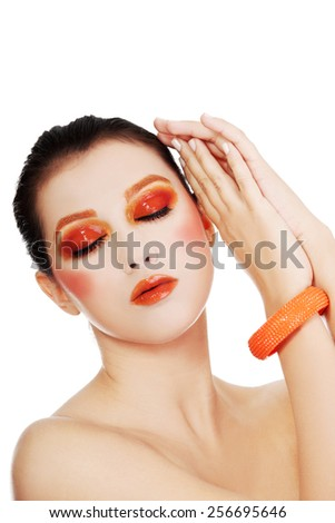 Young beautiful woman in full make up - stock photo