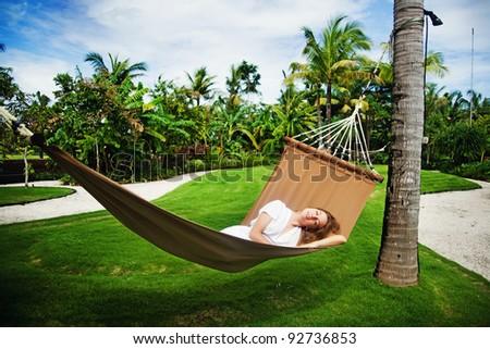 Young beautiful woman in hammock, Bali, Indonesia - stock photo
