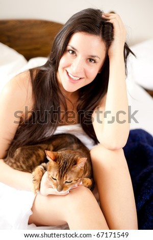 Young Beautiful Woman in Her Bedroom with a Cute Cat