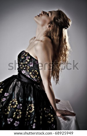 young beautiful woman in nice dress - stock photo