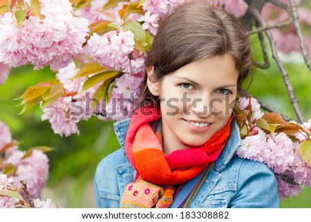 Young beautiful woman in sprng garden