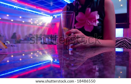 Young beautiful woman in the nightclub