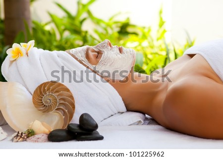 Young beautiful woman in tropical spa - stock photo