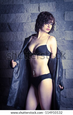 young beautiful woman in underwear and a raincoat - stock photo