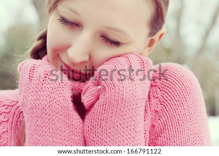 Young beautiful woman in winter clothes. Portrait outdoors  - stock photo