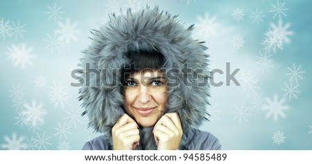 Young beautiful woman in winter hat