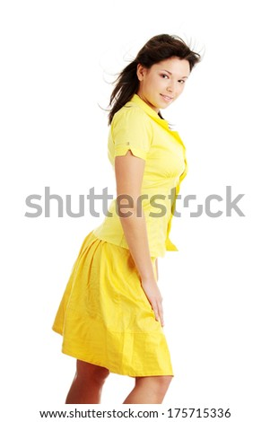 Young beautiful woman in yellow summer dress and yellow shirt, isolated on white background