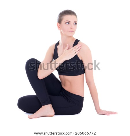young beautiful woman in yoga pose isolated on white background - stock photo