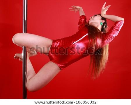 Young beautiful woman is dancing. - stock photo