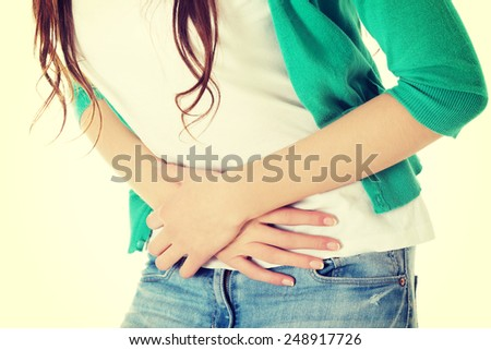Young beautiful woman is having stomach ache.  - stock photo