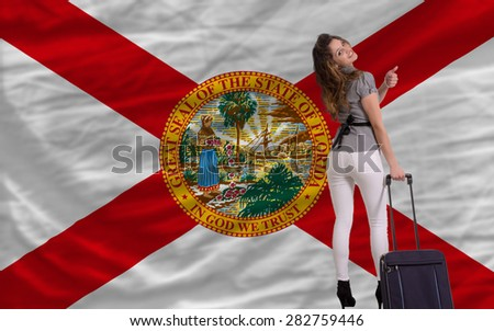 young beautiful woman is traveling to florida - stock photo