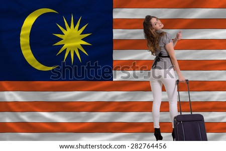 young beautiful woman is traveling to malaysia - stock photo