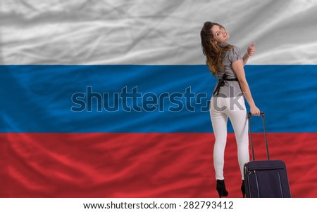 young beautiful woman is traveling to russia - stock photo