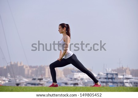 Young beautiful  woman jogging and running  on morning at  park in the city. Woman in sport outdoors health and fitness concept