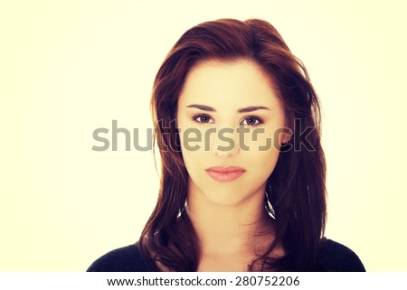 Young beautiful woman looking angry - stock photo