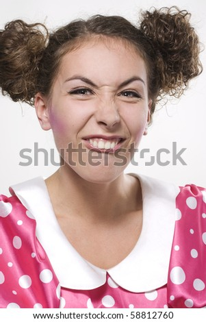 Young beautiful woman making a funny face - stock photo
