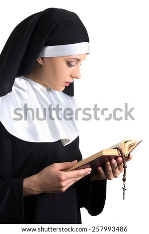 young beautiful woman nun with bible and rosary isolated on white background - stock photo