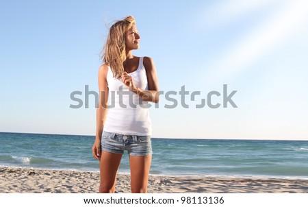 young beautiful woman on beach background - stock photo