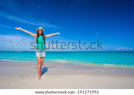 Young beautiful woman on beach during her summer vacation