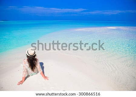 Young beautiful woman on beach during tropical vacation - stock photo
