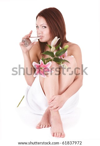 Young beautiful woman on massage table in beauty spa. - stock photo