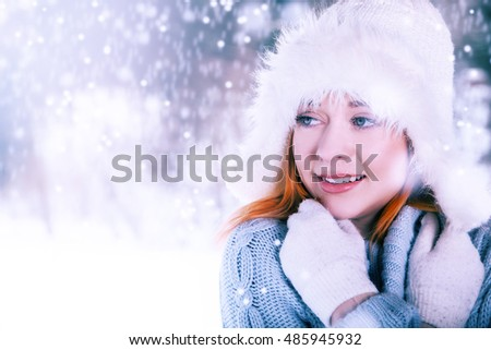 Young beautiful woman on the winter background