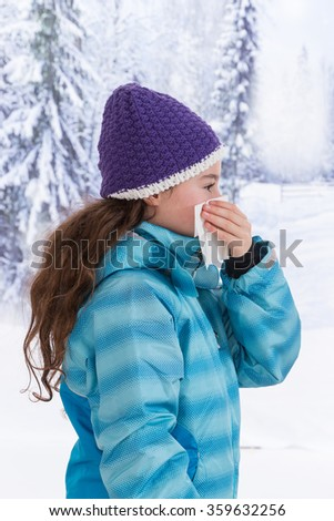 Young beautiful woman outdoor blowing nose in winter  - stock photo
