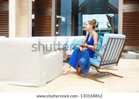 Young beautiful woman outdoors sitting in hotel lobby, bali - stock photo