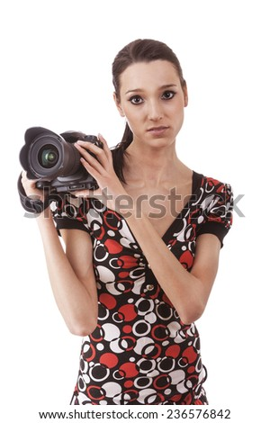 Young beautiful woman photographed on camera, isolated on white background. - stock photo