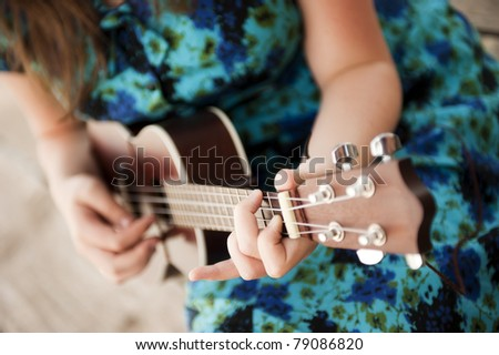 Young beautiful woman playing music outdoors - stock photo