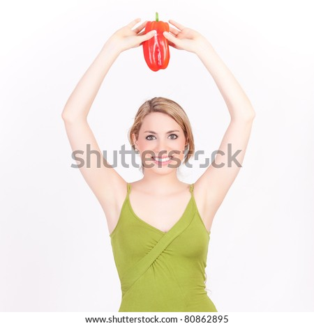 young beautiful woman playing with a pepper isolated on white background - stock photo