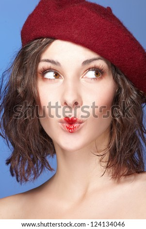 young beautiful woman playing with heart drawing on lips. Valentine's day - stock photo