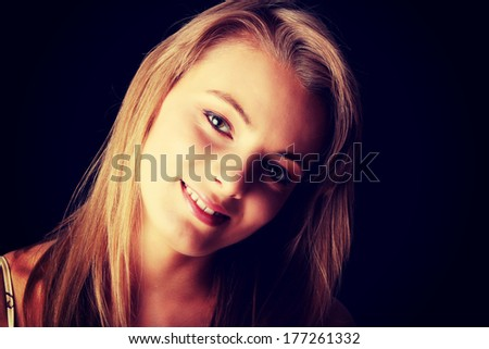 Young beautiful woman portrait isolated on black background - stock photo