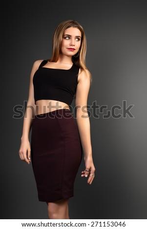 Young beautiful woman portrait with long hair in studio shot. Teen girl beautiful cheerful enjoying.  - stock photo