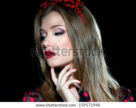 Young beautiful woman portrait with wreath of flowers studio shot. Rock style girl