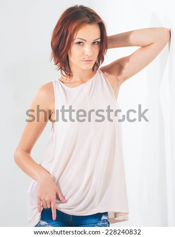 young beautiful woman posing in studio on white background - stock photo
