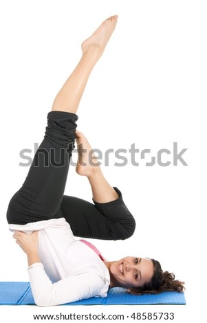 young beautiful woman practicing flexibility gym