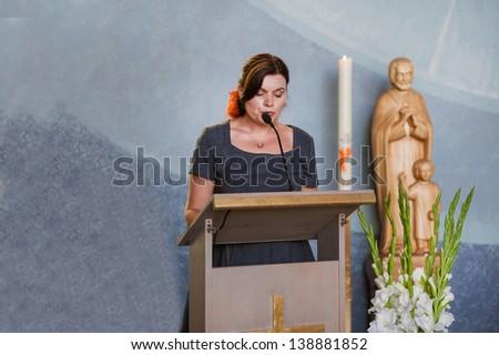 Young beautiful woman preaching in christian church - stock photo