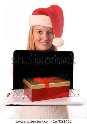 Young beautiful woman  presenting laptop for online Christmas shopping - stock photo