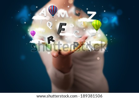Young beautiful woman presenting magical abstract clouds and balloons concept