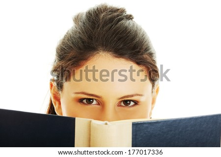 Young beautiful woman reading book  - stock photo