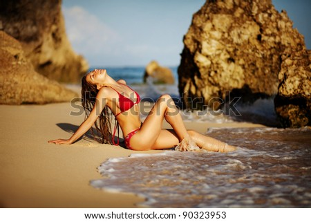 Young beautiful woman relaxing on the shore. Bali. - stock photo