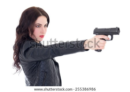 young beautiful woman shooting with gun isolated on white background - stock photo