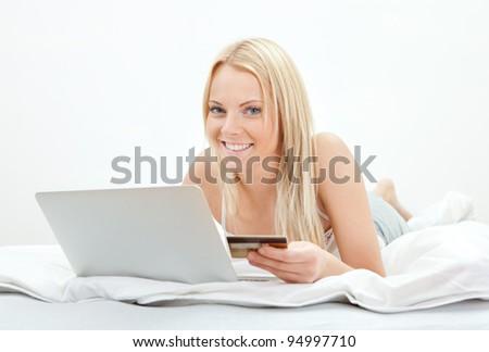 Young beautiful woman shopping using laptop - stock photo
