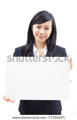 Young beautiful woman showing billboard, isolated on white background - stock photo