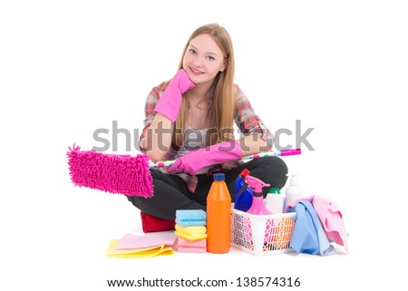 young beautiful woman sitting with cleaning equipment isolated on white background - stock photo
